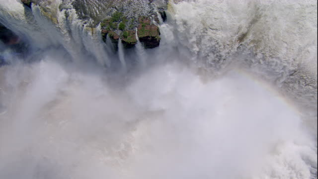 A heavy mist fills the chasm below the Iguazu Falls. Available in HD.