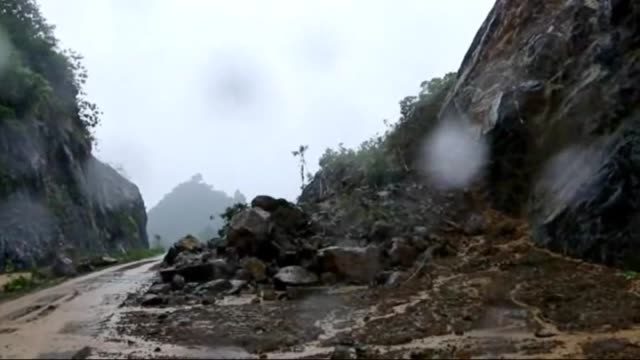 heavy monsoon rains trigger floods and landslide, homes and roads are destroyed by flood waters in jakarta, indonesia on 7 november, 2014. - java stock videos & royalty-free footage