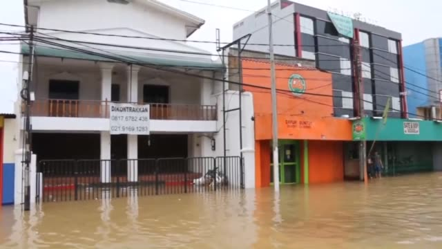 Heavy monsoon rains trigger floods homes and roads are destroyed by flood waters in Jakarta Indonesia on 20 November 2014