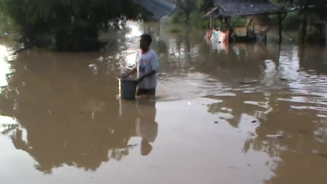 Heavy monsoon rains trigger floods in Surakarta city of Central Jawa region and Indonesians have difficulty while walking on the roads on 24 April...