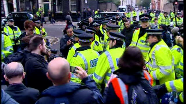 heavy police presence at student protests england london ext protesters along with placards protesters and banner police officers along police... - trattenere video stock e b–roll