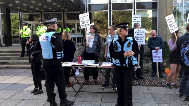 a heavy police presence guards kirklees magistrates court as 31 people appear charged as part of the huddersfield sex abuse investigation on august... - appearance stock videos & royalty-free footage