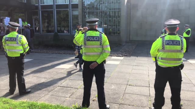 a heavy police presence guards kirklees magistrates court as 31 people appear charged as part of the huddersfield sex abuse investigation on august... - ウェストヨークシャー点の映像素材/bロール