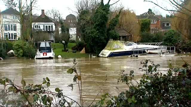 heavy rain and storms cause further disruption kent ext heavily swollen river halfsubmerged boat in river river with burst banks flooding into... - maidstone stock videos and b-roll footage