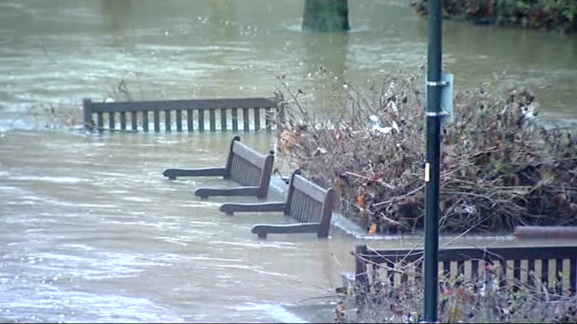 heavy rain and storms cause further disruption maidstone partially submerged benches in flooded area - 2013 stock videos & royalty-free footage