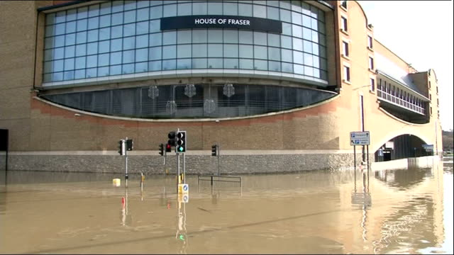 heavy rain and storms cause further disruption tunbridge wells flooded street outside house of fraser department store swollen river - 2013 stock videos & royalty-free footage