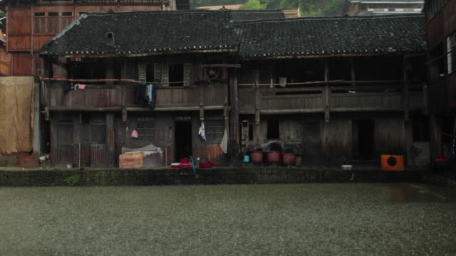 heavy rain at a rural chinese village - village stock videos & royalty-free footage
