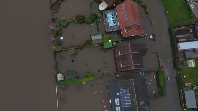 heavy rain brings further flooding ahead of arrival of storm jorge; england: yorkshire: east cowick: ext air views / aerials views of flooded village - natural disaster stock videos & royalty-free footage