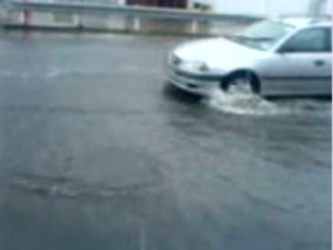 video of cars driving along flooded street - 2007 stock-videos und b-roll-filmmaterial