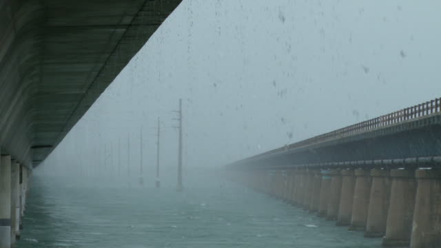 Heavy rain falling at the Seven Mile Bridge in Marathon Florida as a tropical thunderstorm passes overhead