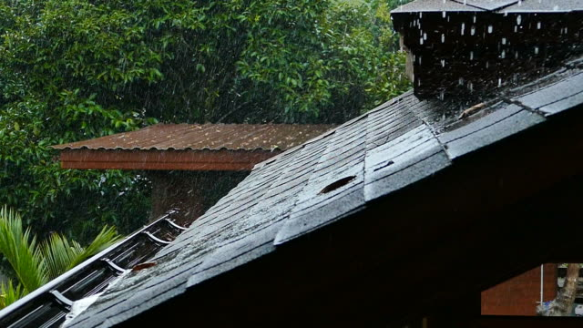 heavy rain falling on a roof - pipe stock videos & royalty-free footage