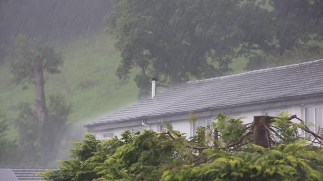 heavy rain falling on houses in ambleside, lake district, uk. - rain stock videos & royalty-free footage