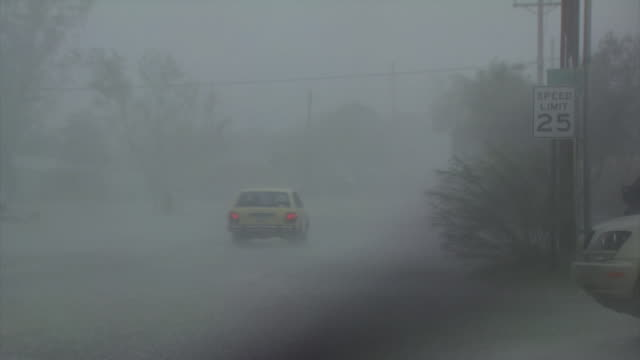 heavy rain falling with gusty wind, filmed through car windscreen, almost hurricane force wind, cars driving down flooded road, arizona, usa - monsoon stock videos and b-roll footage