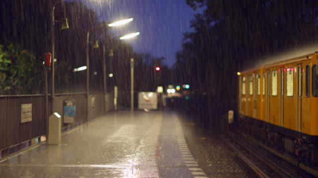 heavy rain on a train station - public transport stock videos & royalty-free footage