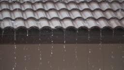 Heavy rain on roof tiles.
