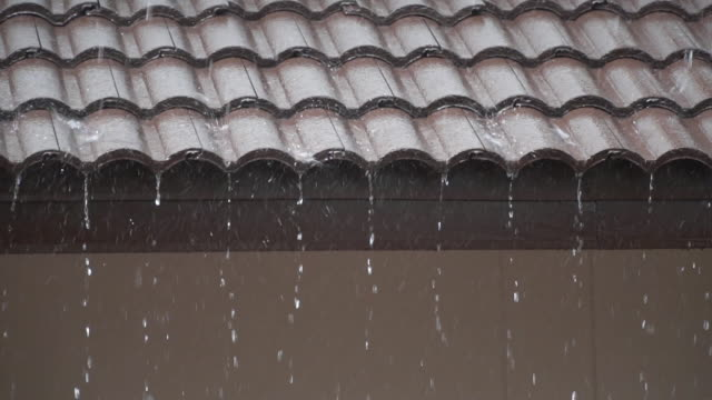 heavy rain on roof tiles. - roof stock videos & royalty-free footage