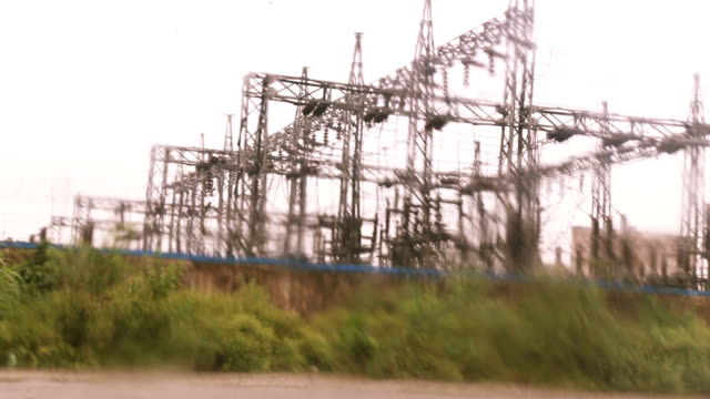 heavy rain on the road near electrical pylons - monsoon stock videos & royalty-free footage