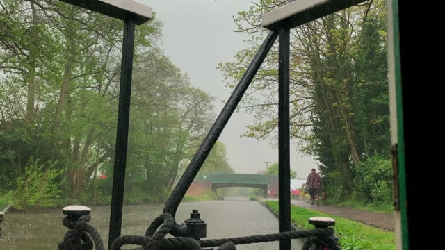 pov heavy rain on trent and mersey canal, england - weather stock videos & royalty-free footage