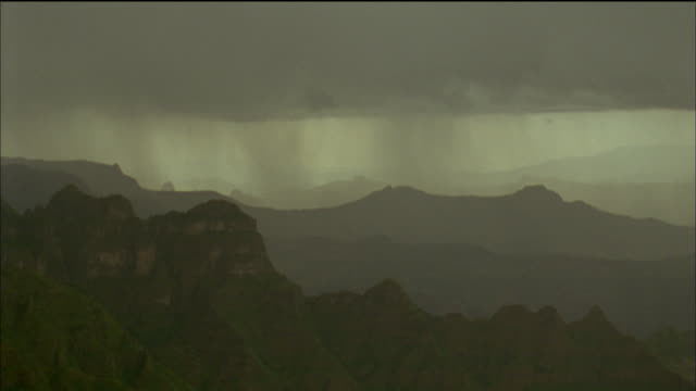 Heavy rainfall sweeps over mountains. Available in HD.