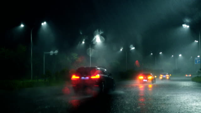 heavy rain,looking from car window - windshield stock videos & royalty-free footage