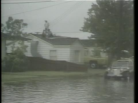 heavy rains flood streets and neighborhoods. - sprinkling stock videos & royalty-free footage