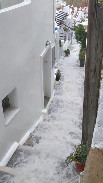 """""""heavy rains in ano syros, greece have led to severe flooding in the city. check out this waterfall effect going down the stairs!"""" - cyclades islands stock videos & royalty-free footage"""