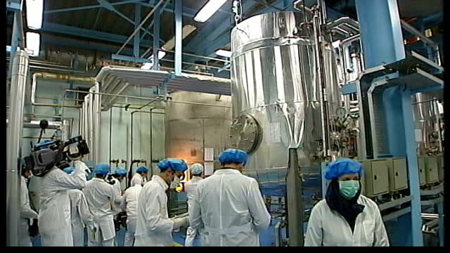 heavy sanctions imposed; int esfahan: workers in facility and close up of uranium enrichment plant - uranium stock videos & royalty-free footage