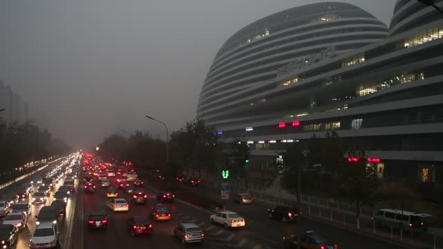 heavy smog attack beijing on nov 29 2014 - 乗り物の明かり点の映像素材/bロール
