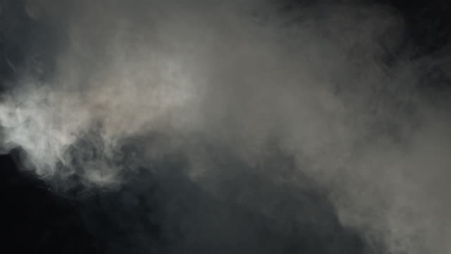 heavy smoke dispersing against black background - thick stock videos & royalty-free footage