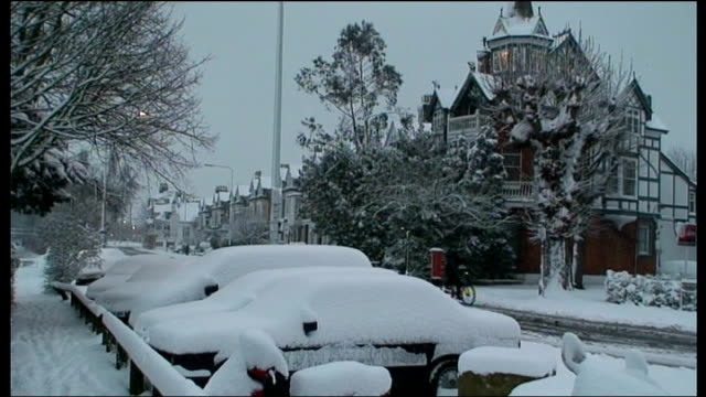 heavy snow across britain causes chaos england london int snowcovered street seen through window cat pawing snow then retreating traffic along... - richmond upon thames stock-videos und b-roll-filmmaterial