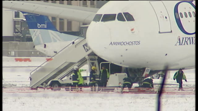 heavy snow across britain causes chaos heathrow airport ext cyprus airways plane on snowcovered verge after sliding off runway maintenance workers... - sliding stock videos & royalty-free footage