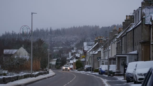 heavy snow and blizzard conditions in bonar bridge sutherland scotland uk - town stock videos & royalty-free footage