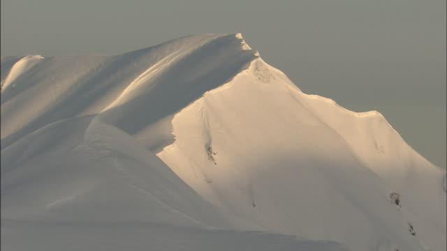 heavy snow blankets the summit of mt. okudainichidake, japan. - toyama prefecture stock videos and b-roll footage