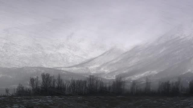 heavy snow falls across the lanscape near tromso, norway.  - 北欧諸国点の映像素材/bロール