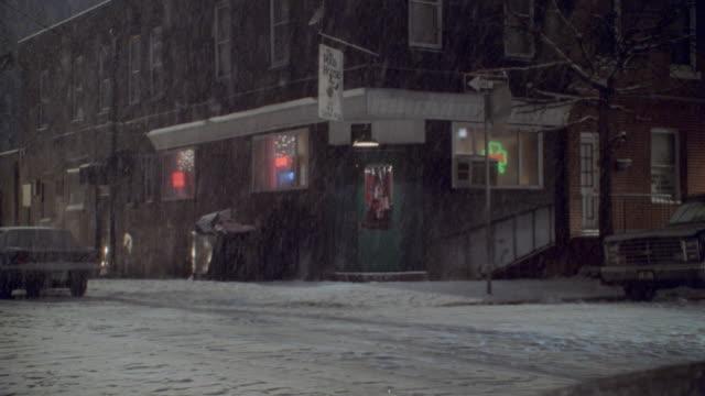 heavy snow falls outside an irish bar. - 2002 stock videos & royalty-free footage