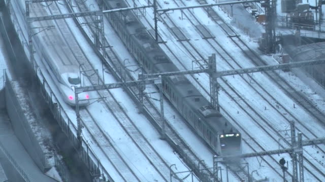 Heavy snow hit many areas of eastern and northeastern Japan on Monday including downtown Tokyo and other locations usually unaccustomed to snowfall...