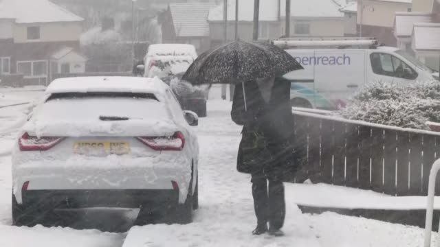 heavy snow hits scotland and northern england; england: ext air view / aerial snow covered countryside man under umbrella walking along snow covered... - itvイブニングニュース点の映像素材/bロール