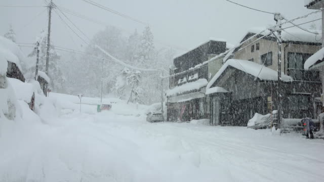 heavy snow hits town in northern japan during major winter storm - blizzard stock videos & royalty-free footage