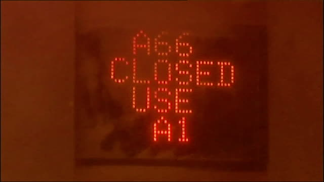Heavy snow leads to school and road closures in north Tyne and Wear Illuminated road sign 'A66 closed use A1' obscured by blizzard conditions