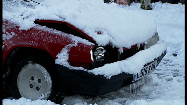 heavy snow nationwide causes further disruption to schools and transport snowy suburban side road car with smashed bonnet in snow at roadside crashed... - canada house stock videos and b-roll footage