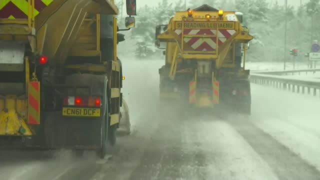 S POINT OF VIEW along road behind gritter lorries