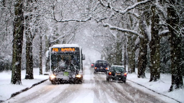 heavy snowfall in slow motion - bus stock videos & royalty-free footage