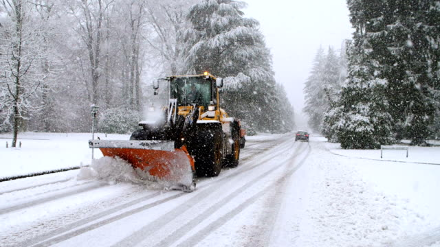 heavy snowfall in slow motion with snowplow - snowplough stock videos & royalty-free footage