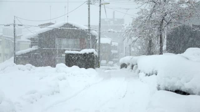 heavy snowstorms blanket town in northern japan in january 2017 - 通行止め点の映像素材/bロール