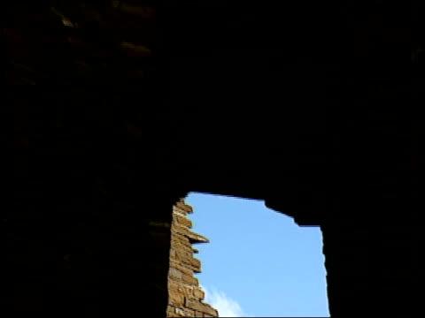 heavy stones form the interior walls of pueblo bonito - pueblo bonito stock videos & royalty-free footage