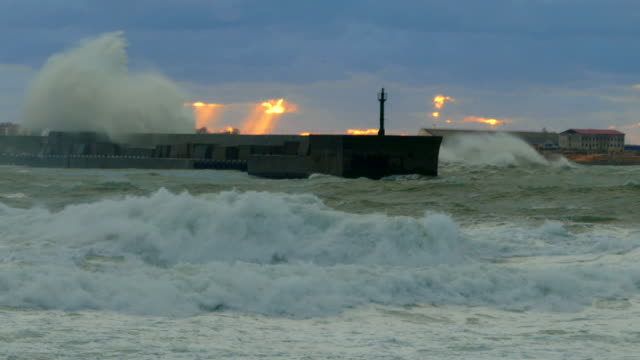 heavy storm and high waves at sunset
