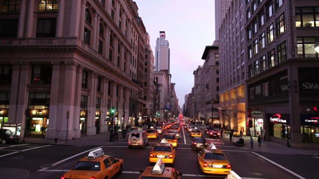 WS HA POV Heavy street traffic at dusk / Manhattan, New York, USA