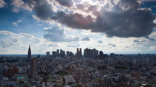 t/l ws ha heavy summer clouds over shinjuku, tokyo, japan - tokyo japan stock videos & royalty-free footage
