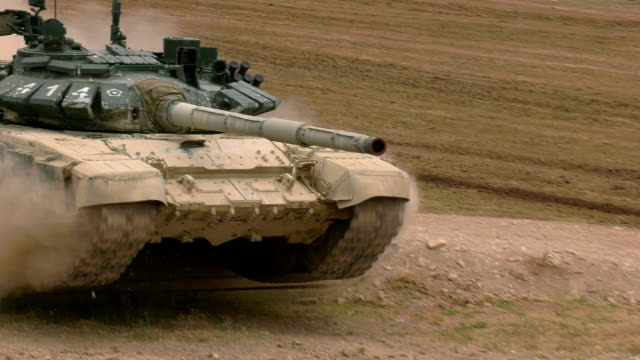 heavy tank jumps off an obstacle at full speed - tank stock videos & royalty-free footage