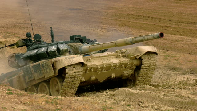 heavy tank overcomes a deep ditch with water and mud - tank stock videos & royalty-free footage